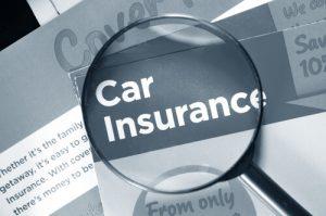magnifying glass highlighting car insurance