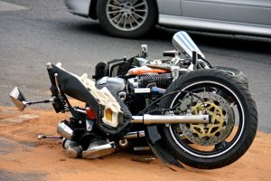 Image of a motorcycle laying on its side after being in an accident. The accident happened in downtown Denver.