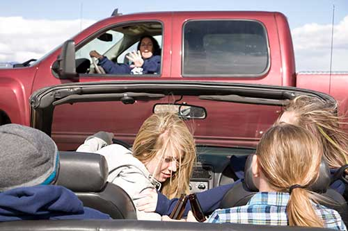 distracted teens about to get in an auto accident